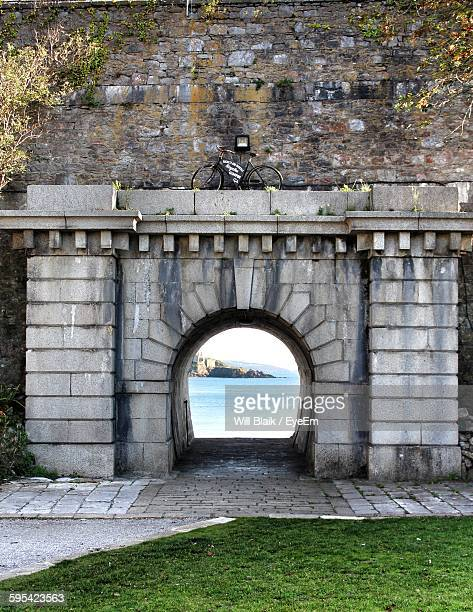 sea seen through arch - plymouth stock photos and pictures