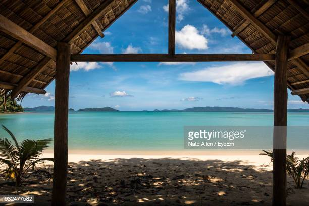 sea seen through hut at beach - filipino culture stock pictures, royalty-free photos & images