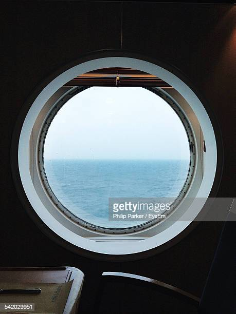 sea seen through porthole - porthole stock photos and pictures
