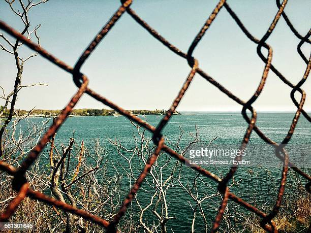 Sea Seen Through Rusty Chainlink Fence