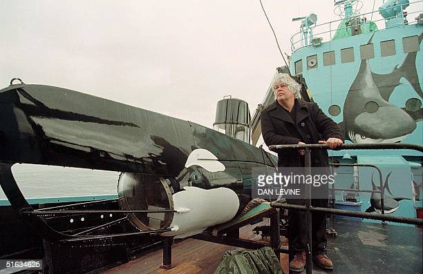 Sea Shepherd captain Paul Watson stands beside the 25foot submarine painted to look like an orca whale and used to emit orca sounds to scare away the...
