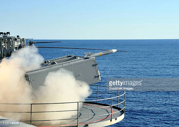 a rim-7 sea sparrow is launched from a mk-57 aboard aircraft carrier uss enterprise. - bang boat stock pictures, royalty-free photos & images