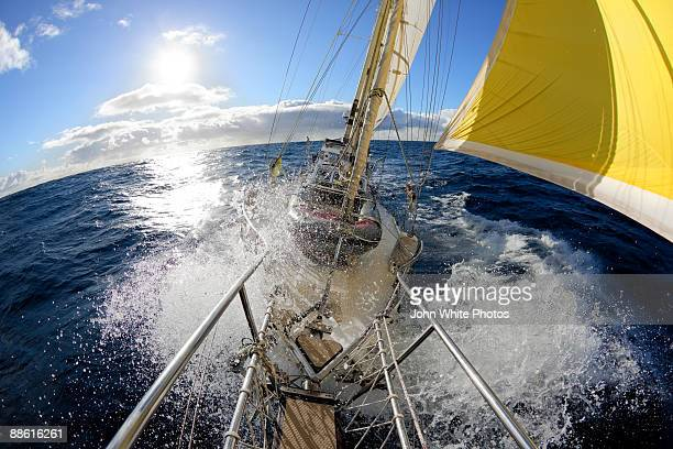 Sea spray from the bow of a ketch
