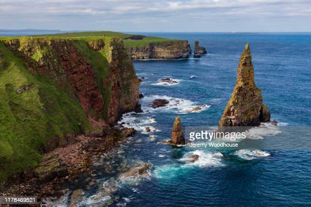 sea stacks at duncansby head - stack rock stock pictures, royalty-free photos & images