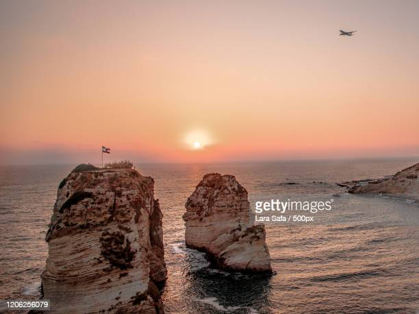 sea stacks at sunset, beirut, lebanon - images stock pictures, royalty-free photos & images