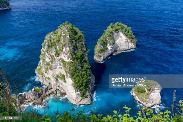sea stacks in nusa penida - regency style stock photos and pictures