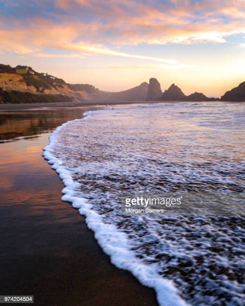 sea stacks in the pacific ocean during sunset - oregon coast stock pictures, royalty-free photos & images