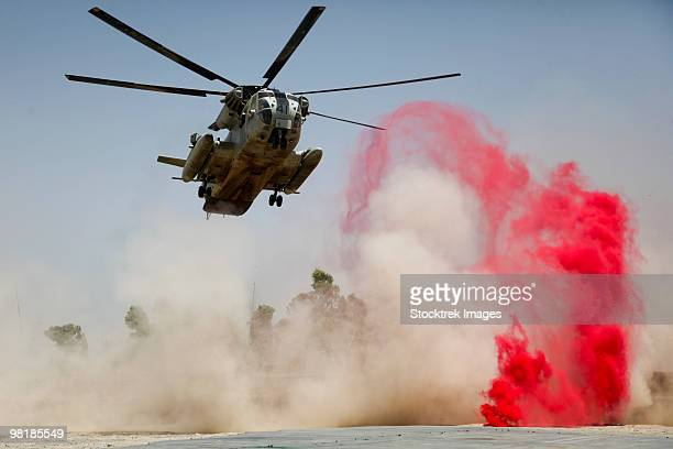 A CH-53D Sea Stallion helicopter landing to deliver supplies at Patrol Base Jaker, Afghanistan.