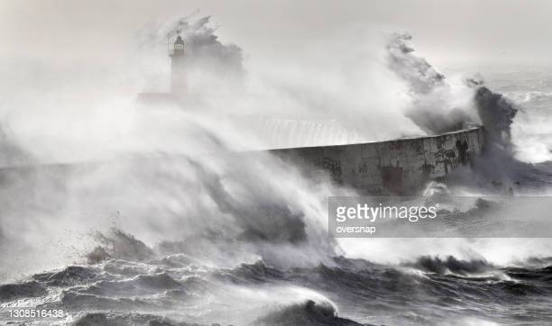 sea storm over the lighthouse - awe stock pictures, royalty-free photos & images