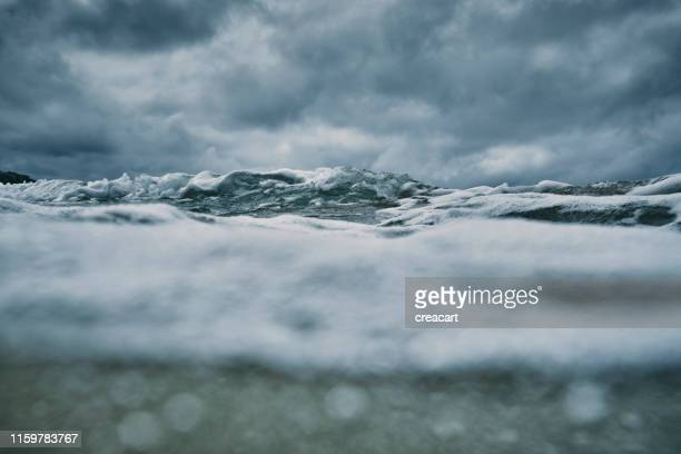 sea surface on a stormy day at fistral beach, newquay, cornwall. - calm before the storm stock pictures, royalty-free photos & images