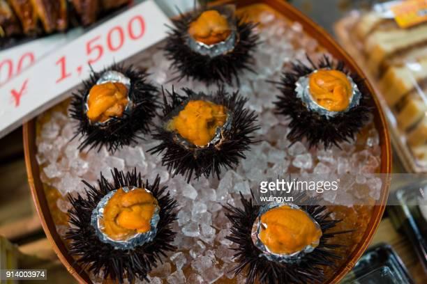 sea urchin sold in kuromon ichiba market, osaka, japan - sea urchin stock pictures, royalty-free photos & images