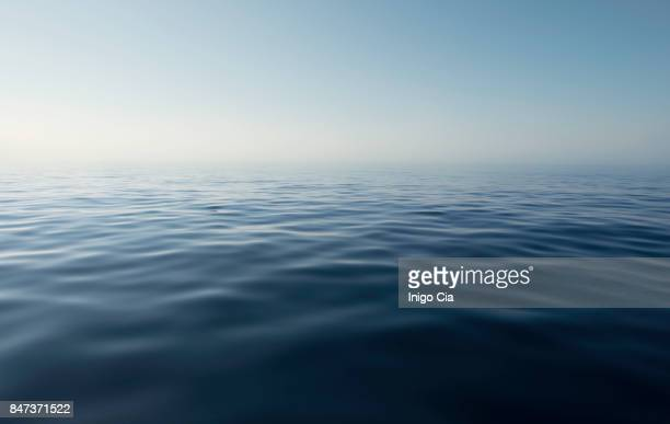 sea view in a calm and quiet day - horizon stockfoto's en -beelden