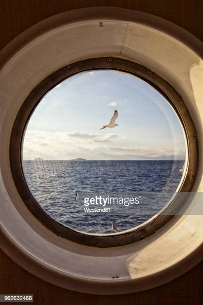 sea view through porthole - porthole stock photos and pictures