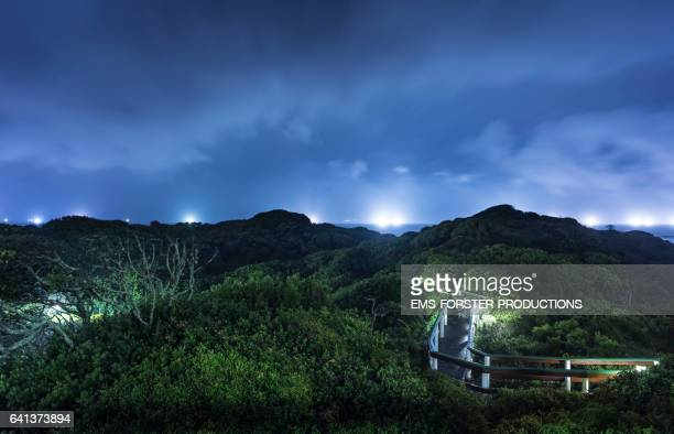 sea view with green bushes and wooden footbridge in foreground - shot-1: nights - eastern cape stock pictures, royalty-free photos & images