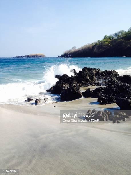 Sea water splashing over the rock