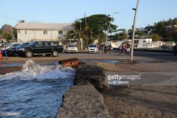 Sea water surging close to the road on the French overseas island of Mayotte in the Indian Ocean on September 29 2019 The high tides recurrent in...