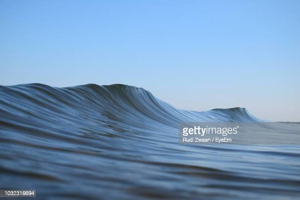 sea waves against clear blue sky - wave stock pictures, royalty-free photos & images