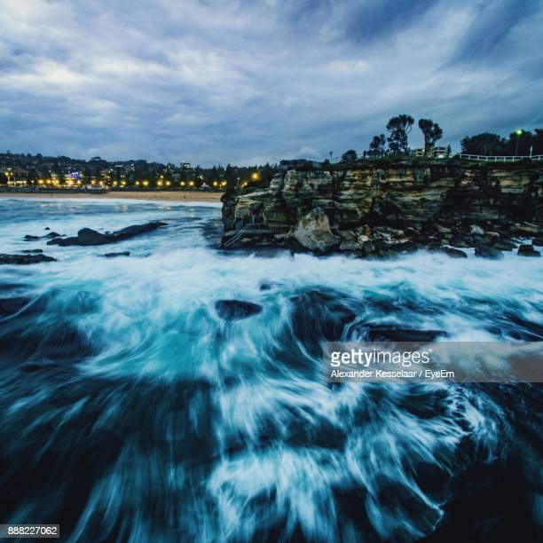 Sea Waves Against Cloudy Sky During Sunset