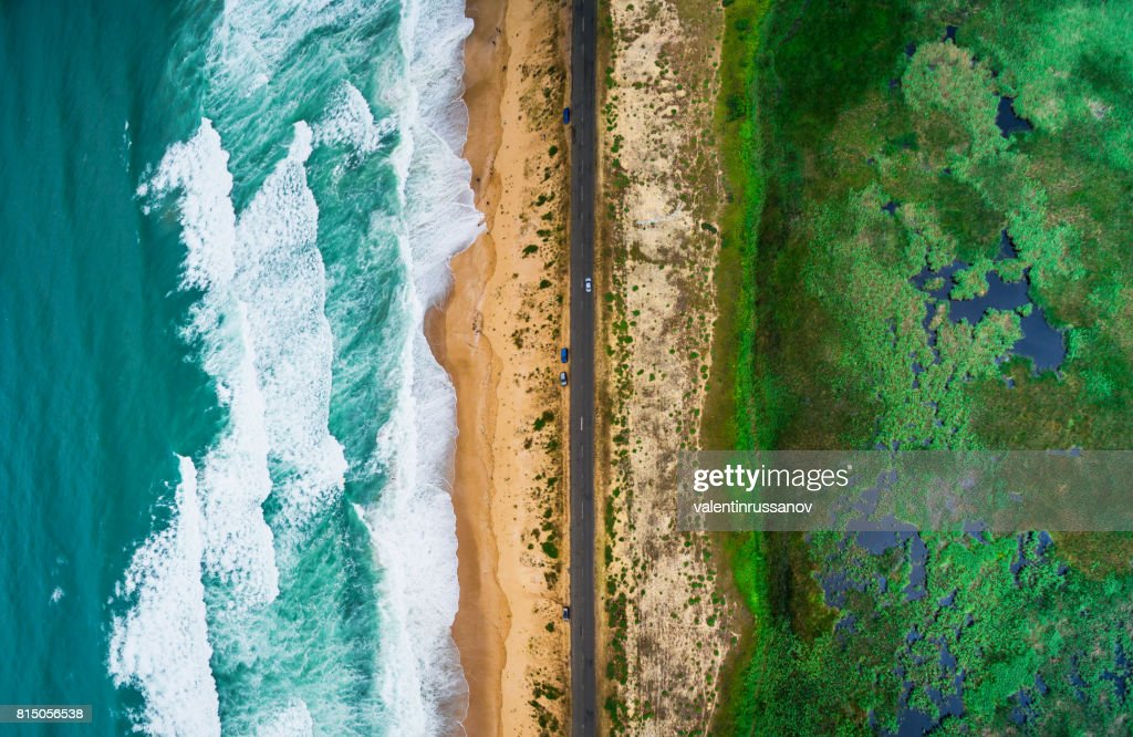 Sea waves, beach and road : Stock Photo