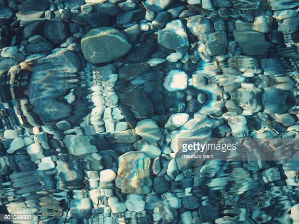 sea with a crystal clear water and pebbles on the bottom