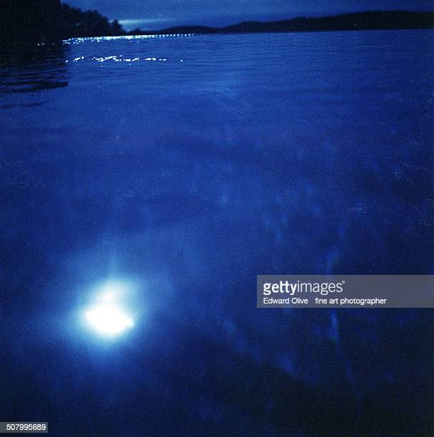 Sea with blue night sky and moonlight