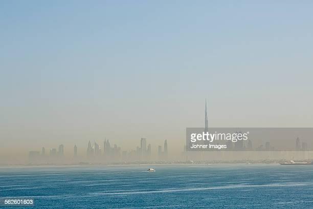 Sea with city skyline