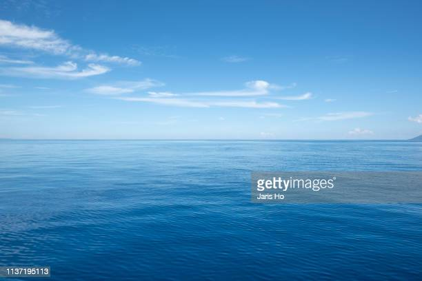 sea with cloud - horizon stock pictures, royalty-free photos & images