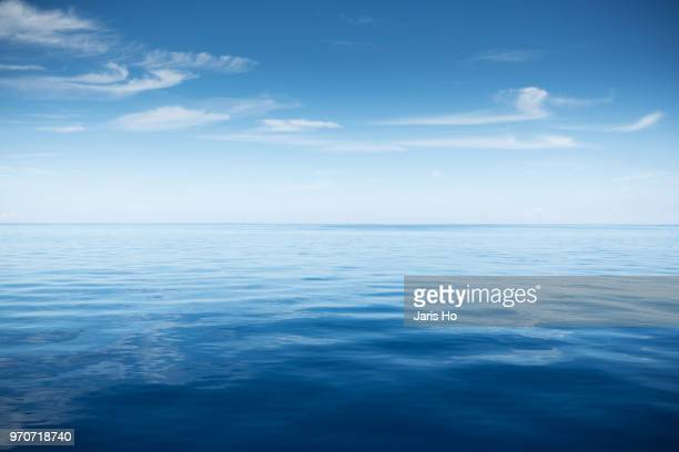sea with cloud - tranquil scene stock pictures, royalty-free photos & images