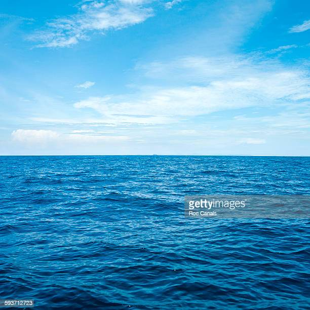 sea with clouds - horizon stock pictures, royalty-free photos & images