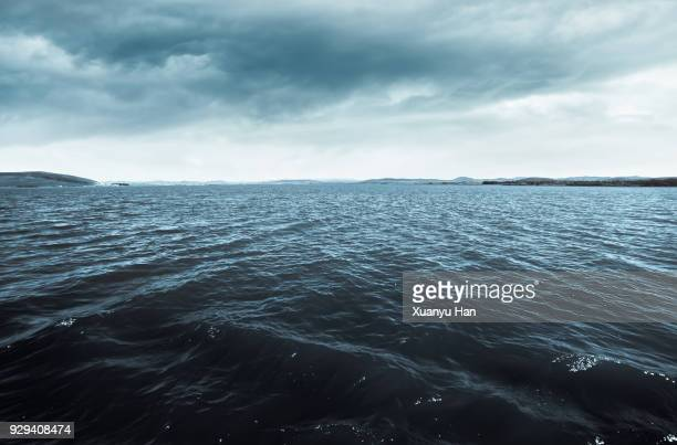 sea with clouds - tide stock pictures, royalty-free photos & images