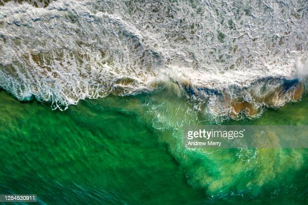 sea with waves crashing on beach, australia, aerial view - tide stock pictures, royalty-free photos & images