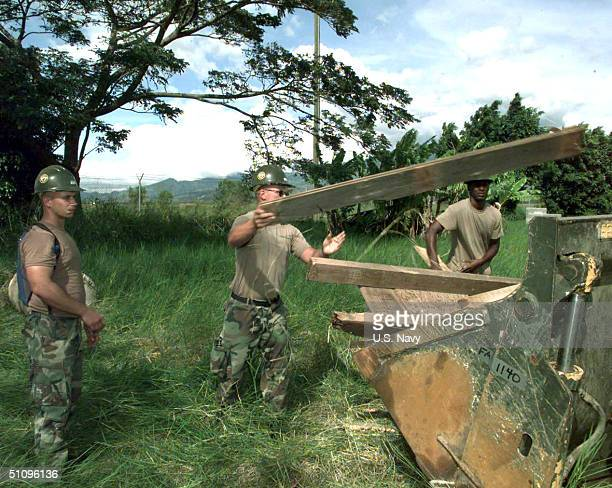 Seabees Assigned To Naval Mobile Construction Battalion Seven Clear Away The Remains Of A Old Building On Soto Cano Air Base In The Republic Of...