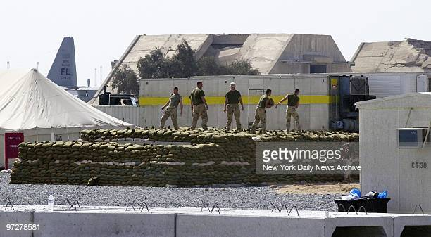 Seabees build a bunker at Al Jaber Air Base in Kuwait New York City firefighters sanitation and transit workers all Navy Seabees called up for a...