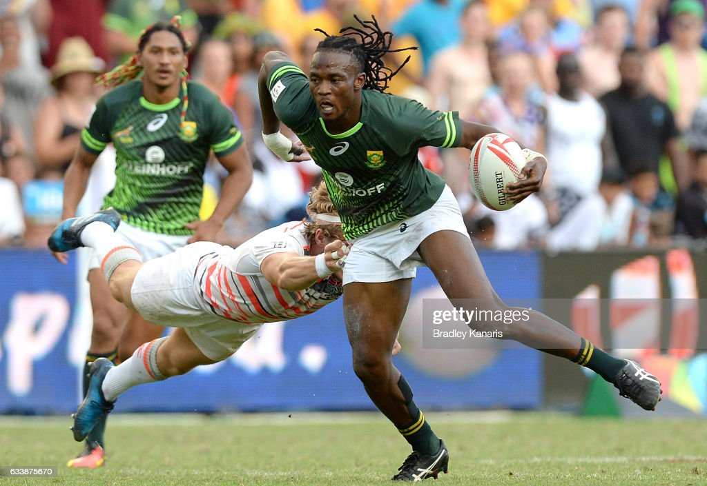 Seabelo Senatla of South Africa breaks away from the defence during the Men's Final match between England and South Africa in the 2017 HSBC Sydney Sevens at Allianz Stadium on February 5, 2017 in Sydney, Australia.