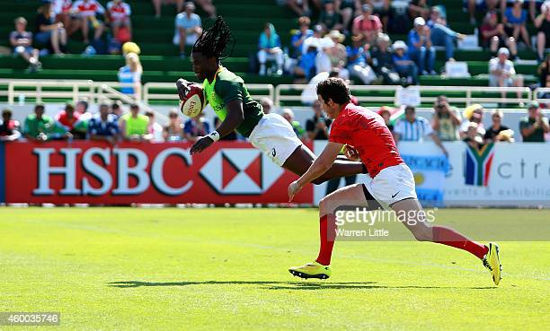 Seabelo Senatla of South Africa dives to score a try against Argentina in the Cup Quarter Final during day two of the Emirates Dubai Sevens HSBC...