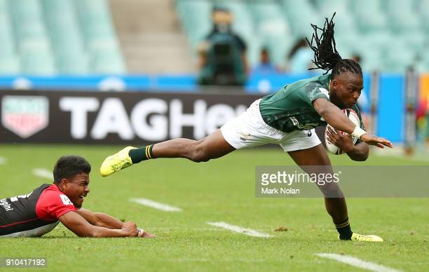 Seabelo Senatla of South Africa is tackled in the mens pool match between South Africa and Papua New Guniea during day one of the 2018 Sydney Sevens...
