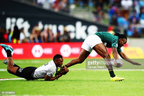 Seabelo Senatla of South Africa makes a break during the Cup final match between Fiji and South Africa during the 2018 New Zealand Sevens at FMG...