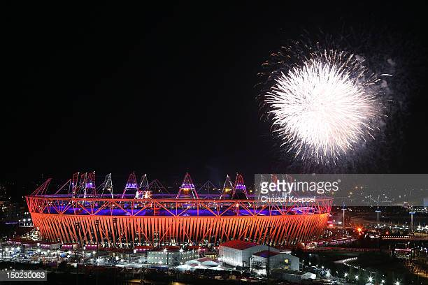 Seachlights over the Olympic Stadium during the closing ceremony of the 2012 London Olympic Games on August 12 2012 in London England Athletes heads...