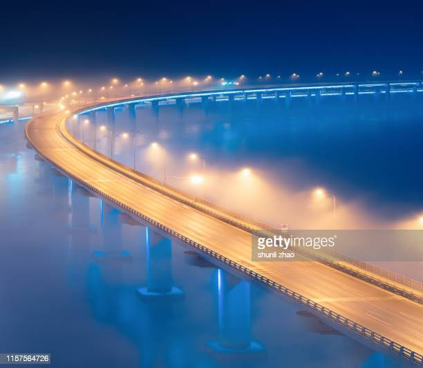 sea-crossing bridge in mist - gold rush imagens e fotografias de stock