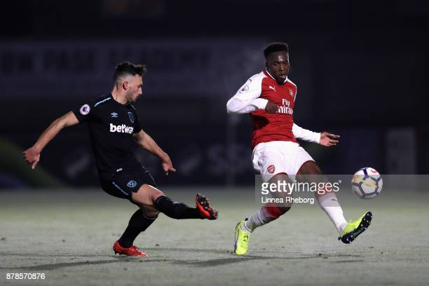 Sead Haksabanovic of West Ham and Tolaji Bola of Arsenal in action during the Premier League 2 match between Arsenal and West Ham United at Meadow...