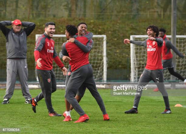 Sead Kolasinac Alex Iwobi Chuba Akpom and Mohamed Elneny of Arsenal during a training session at London Colney on November 21 2017 in St Albans...