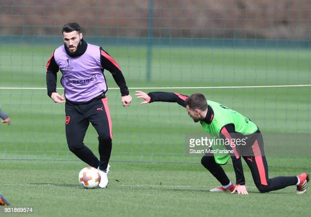 Sead Kolasinac and Aaron Ramsey of Arsenal during a training session at London Colney on March 14 2018 in St Albans England
