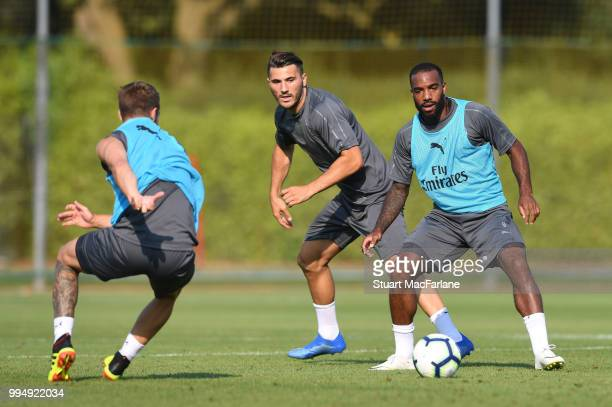 Sead Kolasinac and Alex Lacazette of Arsenal compete for the ball during a training session at London Colney on July 9 2018 in St Albans England