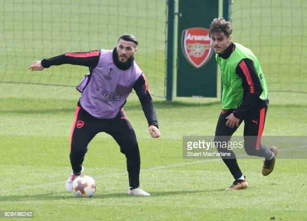 Sead Kolasinac and Konstantinos Mavropanos of Arsenal during a training session at London Colney on March 7 2018 in St Albans England