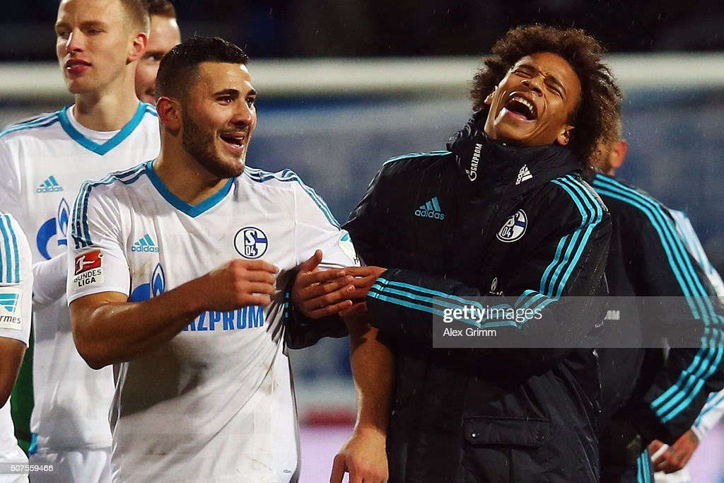 Sead Kolasinac (L) and Leroy Sane of Schalke laugh after the Bundesliga match between SV Darmstadt 98 and FC Schalke 04 at Merck-Stadion am Boellenfalltor on January 30, 2016 in Darmstadt, Germany.