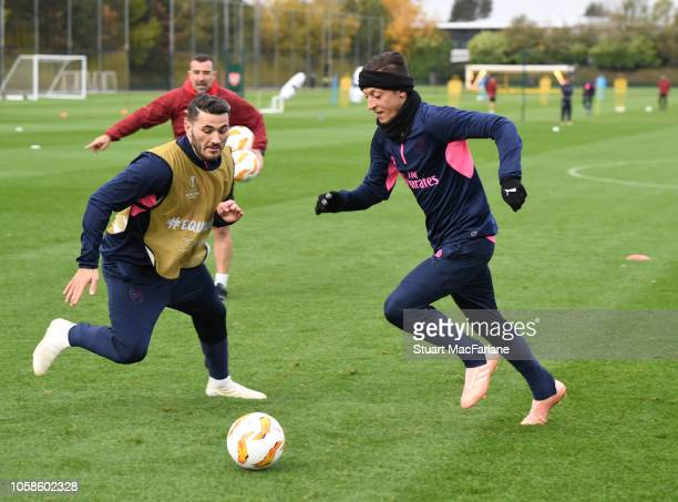 Sead Kolasinac and Mesut Ozil of Arsenal during a training session at London Colney on November 7 2018 in St Albans United Kingdom