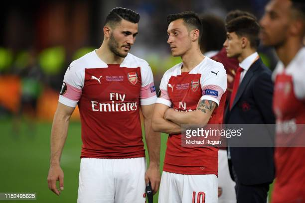 Sead Kolasinac and Mesut Ozil of Arsenal look dejected following their sides defeat in the UEFA Europa League Final between Chelsea and Arsenal at...