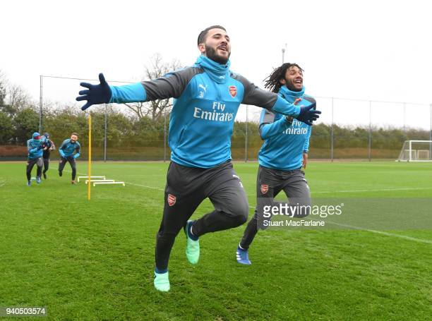 Sead Kolasinac and Mo Elneny of Arsenal during a training session at London Colney on March 31, 2018 in St Albans, England.
