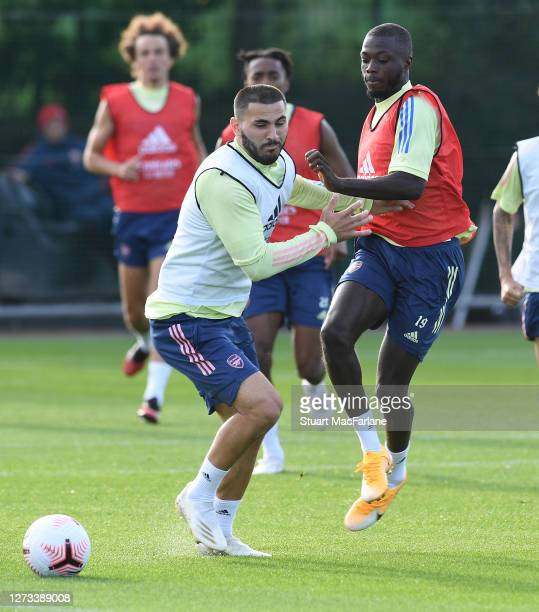 Sead Kolasinac and Nicolas Pepe of Arsenal during a training session at London Colney on September 18 2020 in St Albans England
