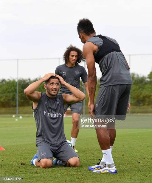 Sead Kolasinac and PierreEmerick Aubameyang of Arsenal during a training session at London Colney on July 16 2018 in St Albans England